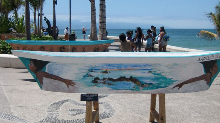 Painted wooden fishing boats, known as pangas, lined the Malecon in Puerto Vallarta.