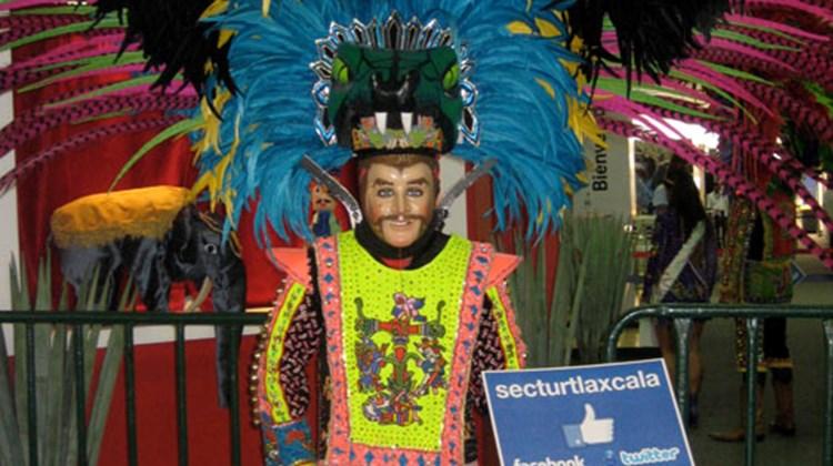 A costumed performer from Tlaxcala (Ta-la-sca-la), a city and state in east-central Mexico.