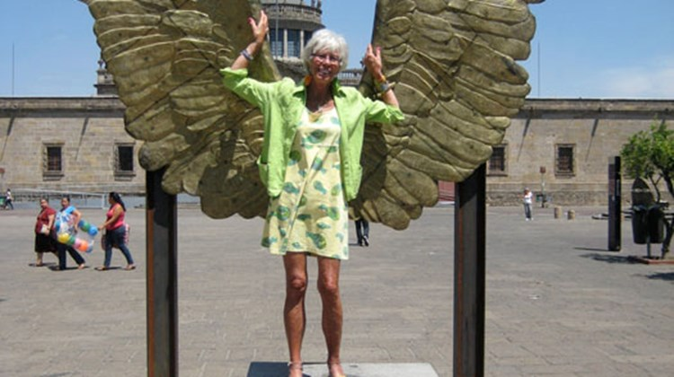 Travel Weekly's Mexico Editor Gay Nagle Myers poses in front of a winged bronze statue near Guadalajara's Cultural Institute.
