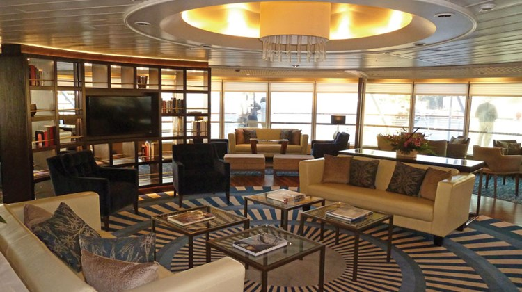 Windstar Cruises has begun sailing the former Seabourn Pride under a new name, Star Pride. After an 18-day drydock, Windstar put its own stamp on a number of public spaces. The former Constellation Lounge is now the Yacht Club (pictured here), and Windstar has installed its trademark Compass Rose lounge where The Club used to be. Windstar is playing up the yacht-like feel of the Star Pride, the first of its ships that won't have sails. See more of the changes in the following slides. TW photos by Tom Stieghorst; posted May 22, 2014