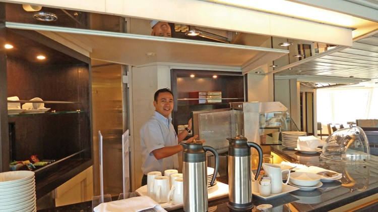 The Yacht Club includes a kitchen and service counter that provides coffees, sweets and light sandwiches.