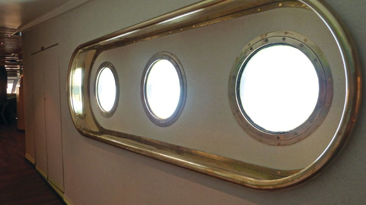 These portholes in a corridor leading to the Compass Rose provide an underwater view of the swimming pool. They had been covered over when Windstar took possession of the ship from Seabourn.