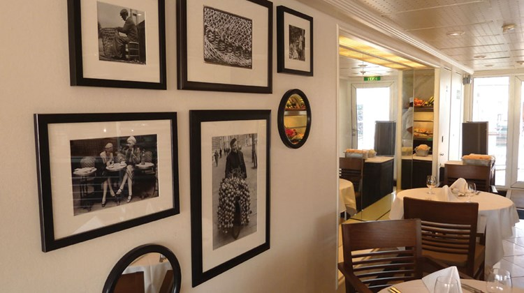 A new photo grouping with French themes, some nautical some not, is a feature of the updated Veranda restaurant, which serves breakfast and lunch and becomes Candles, a specialty restaurant, at night.