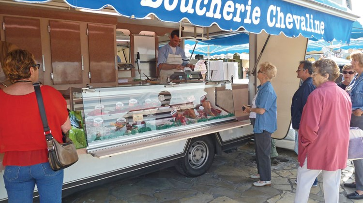 A mobile meat counter at the market in Sanary-Sur-Mer.
