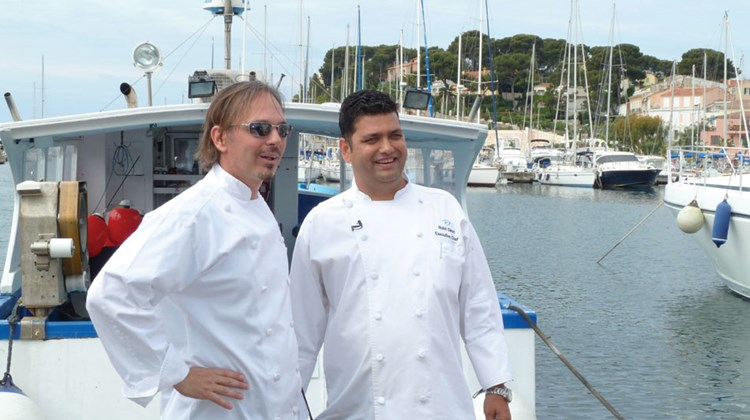 Chefs Michael Sabourin and Rohit Dimri in front of the boat that caught the evening's tuna dinner.