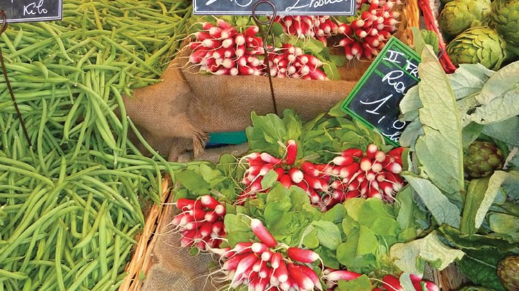 Bunches of radishes on display at the market.