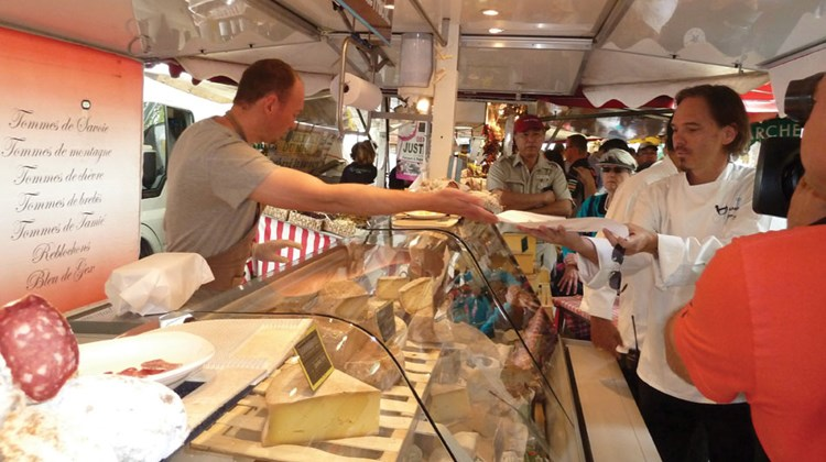 Chef Michael Sabourin gets cheese samples on waxed wrapping paper.