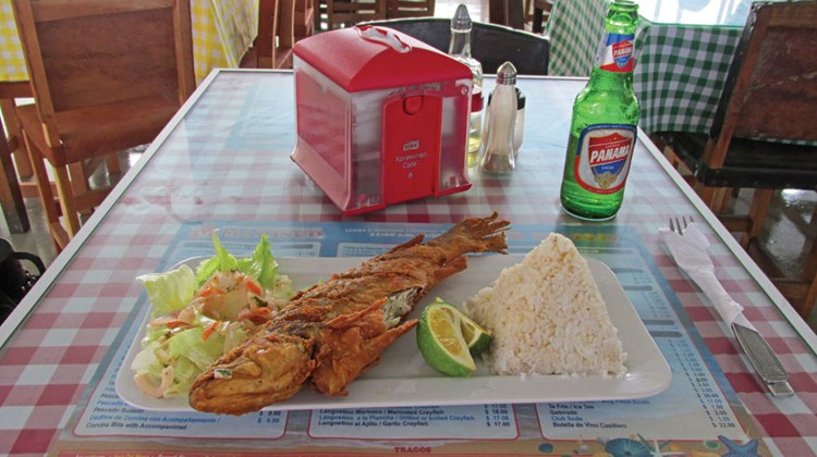 Whole fried corvina with coconut rice at the Mercado de Mariscos' upstairs restaurant.
