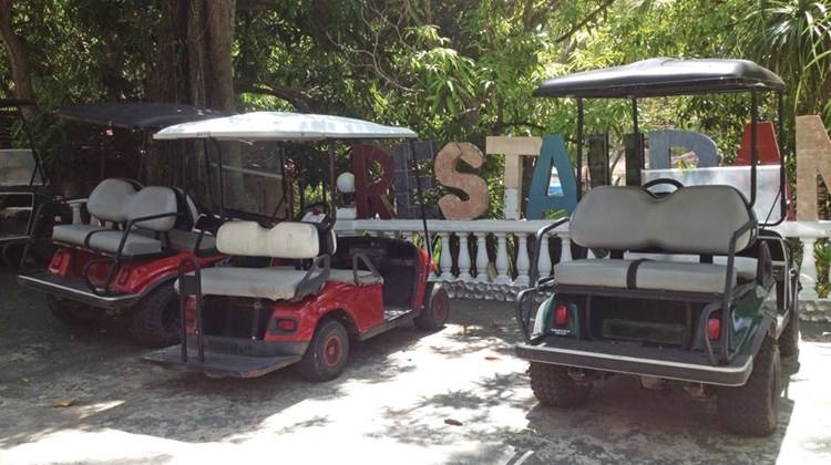 A two-hour ferry ride from Panama City, Contadora Island in the Gulf of Panama offers respite from the city's bustle. Golf carts, pictured in front of the restaurant at the Hotel Villa Romantica, are the primary mode of transportation on the island.