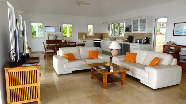 The common area is at L'enclos villa is a large, open-air, kitchen, dining and living room area.
