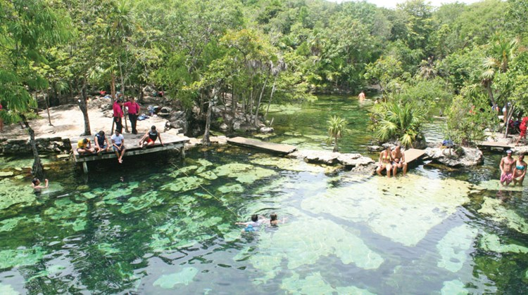Aerial shot of natural water park, Cenote Azul, located in Riviera Maya, about an hour's drive from the JW Marriott Cancun. Cenotes are groundwater holes fed by the Yucatan's underground rivers and were sacred to Mayans.