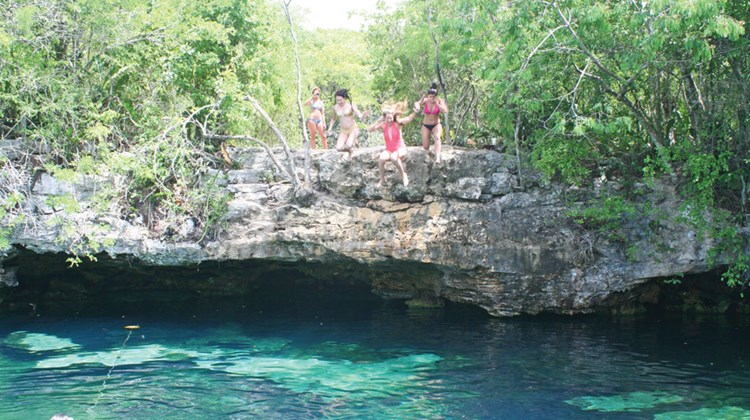 Cliff jumping at Cenote Azul.