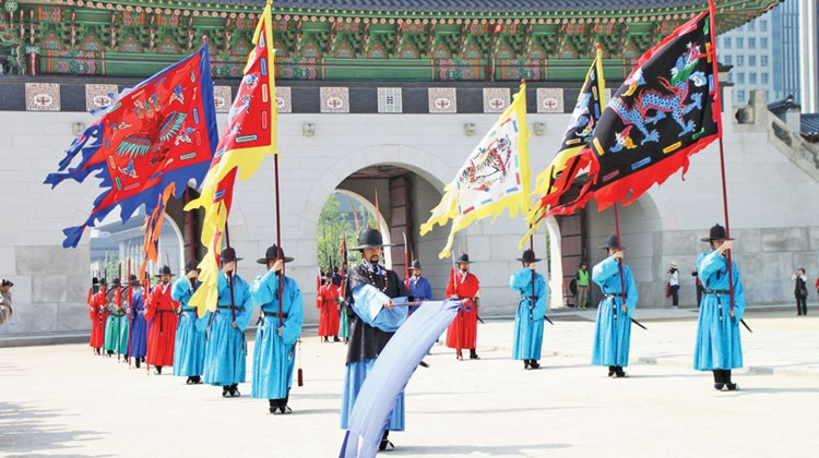 Costumed reenactors demonstrate the traditional changing of the guard ceremony at Seoul's Gyeongbok Palace.
