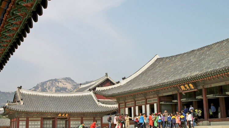 Part of the royal residential area in Gyeongbok Palace, with a bit of mountain scenery in the background.