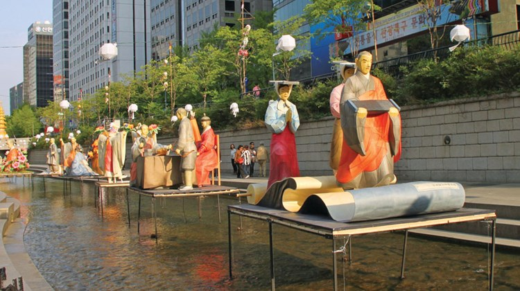Figures, made of traditional Korean paper, floating on Seoul's Cheonggye Stream. Effectively oversized lanterns, these floats were part of a temporary special exhibit.