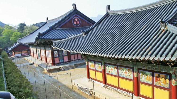 The brightly painted Daebiro Hall, seen in the foreground, at Haeinsa Temple in the mountains south of Seoul. The main hall for services, seen in the rear, carries this name: Daejeokgwangjeon.