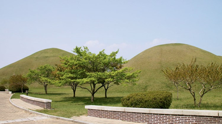 Grass-covered burial mounds seen in the Daereungwon Tomb Complex in Gyeongju, a former capital of Korea. There are 155 such mounds in the city's downtown.
