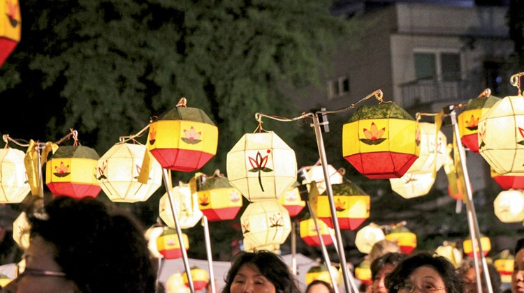 Celebrating with lanterns, marchers hold the pieces aloft during the Lotus Lantern Festival's closing night parade in Seoul this spring.