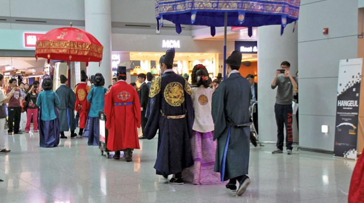 In a surprise for tourists, reenactors begin a slow Walk of the Royal Family through Seoul's Incheon International Airport. The walk is described as typical of the last Korean royals, the Choson (or Joseon) Dynasty (1392-1910). Posted signage said the walk occurs three times daily and takes an hour -- plenty of time for many passengers to get an eyeful and a great way to end a trip to Korea.