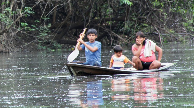A local family that has gathered turtle eggs in its dugout canoe. The eggs will be turned over to conservation officials for protection.