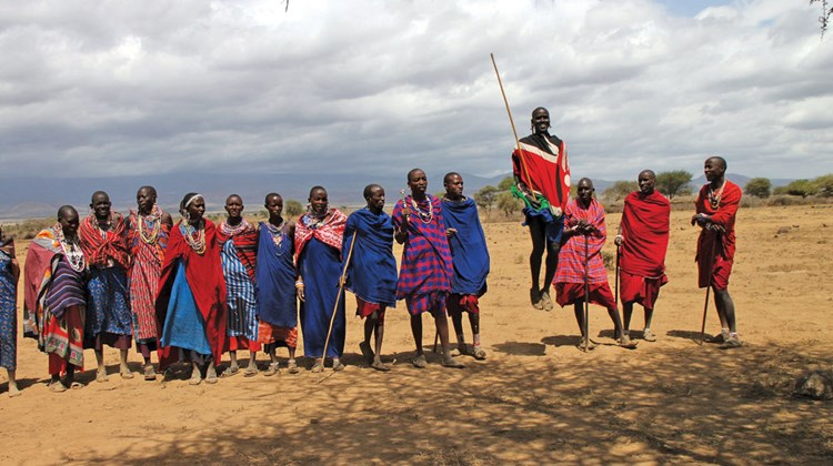 The Maasai typically welcome visitors with singing and jumping displays. These villagers live near Amboseli National Park in southern Kenya.
