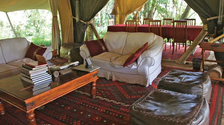 The lounge, with dining space at the rear, in the main tent at Mara Toto, a Great Plains Conservation property just inside the Maasai Mara National Reserve.