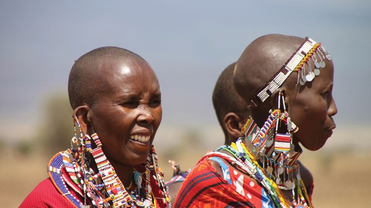 Maasai women, adorned with traditional beaded earrings and necklaces, were among villagers welcoming visitors to their home near Amboseli National Park.