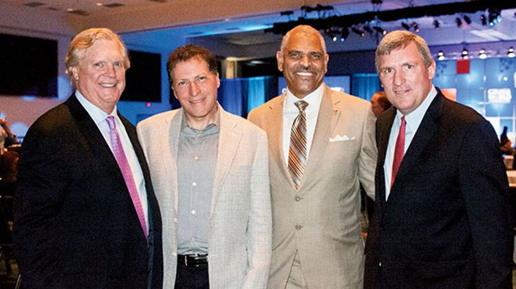 From left: Northstar Travel Media Chairman and CEO Thomas Kemp, Editor in Chief Arnie Weissmann, Carnival Corp. CEO Arnold Donald and Group Publisher Bob Sullivan. Photo by Ed McDonald