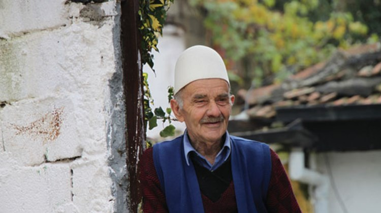 A Prizren man greets visitors.