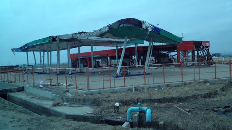 A former gas station that was destroyed by the tsunami. Photo by Johanna Jainchill