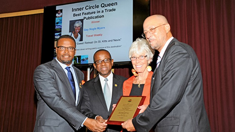 The Caribbean Tourism Organization presented an award to Travel Weekly Caribbean Editor Gay Nagle Myers for the best feature in a trade publication in 2012 for her report on St. Kitts and Nevis; from left, Nevis Tourism Minister Mark Brantley, CTO Secretary General Hugh Riley, Myers and St. Kitts Tourism Minister Ricky Skerritt.