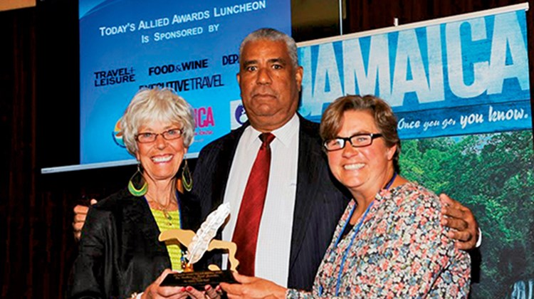 Caribbean Editor Gay Nagle Myers received the Jamaica Tourist Board's Marcia Vickery Wallace Memorial Award for excellence in travel journalism. Pictured with Myers, left, are board Director John Lynch and Kate Wallace Rogers, Wallace's daughter.