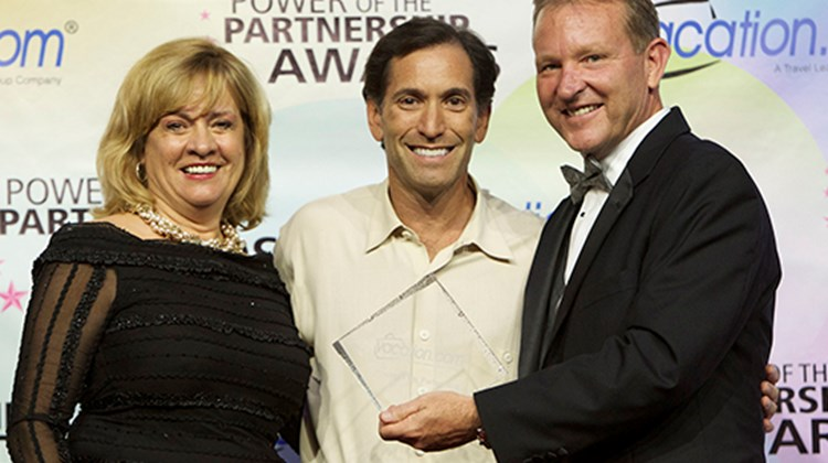 Vacation.com's Viera and Lovell also presented David Fishman of Cadillac Travel with the 2013 President's Award for Top New Newcomer Member.