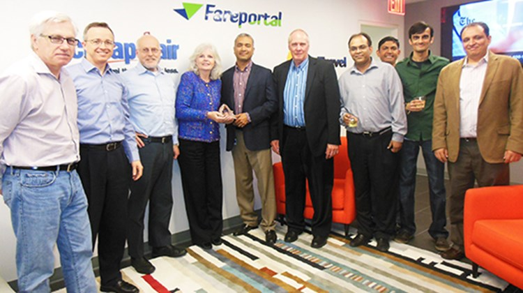Fareportal and its affiliate Travelong, a full-service travel agency, received the Peak of Excellence Award from Sabre Travel Network for the fourth year running. The award was presented to Fareportal/Travelong CEO Sam Jain, fifth from left, by Sabre Vice President Gerry More-Murray, fourth from left, and Account Director Bob Clark, fifth from right, at Fareportal's corporate headquarters in New York.