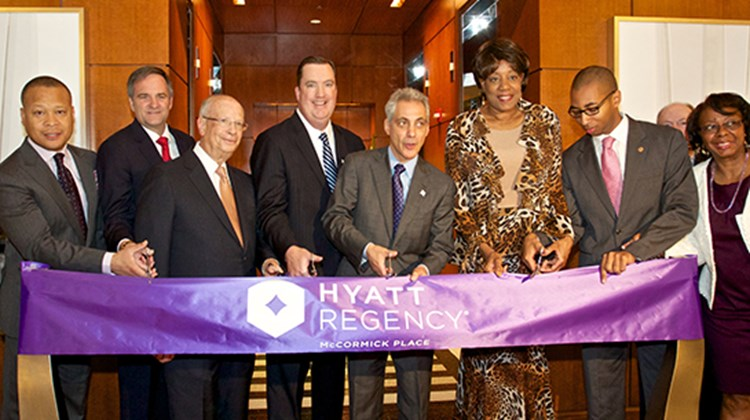 Chicago Mayor Rahm Emanuel cuts the ribbon to mark the completion of a $110 million expansion and renovation of the Hyatt Regency McCormick Place.  The hotel is now Hyatt's fourth-largest hotel in the world and is the fourth-largest hotel in Chicago. From left, Illinois State Rep. Ken Dunkin; David Phillips of Hyatt Hotels; MPEA Chairman Jack Greenberg; Hyatt Regency McCormick Place General Manager Paul Daly; Emanuel; Chicago Alderman Pat Dowell; State Rep. Christian Mitchell; and State Sen. Mattie Hunter.