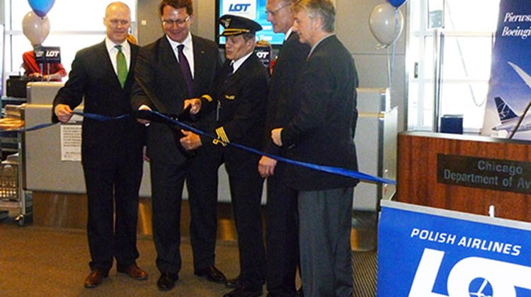 LOT Polish Airlines inaugurated 787 Dreamliner daily, nonstop service from Chicago to Warsaw on June 5, the first international Dreamliner flight from O'Hare Airport. Participating in the ribbon-cutting to mark the event were, from left, Michael Boland, City of Chicago Aviation Department; Tomasz Dakowski, LOT Polish director of sales; Capt. Krzysztof Lenartowicz, who piloted the first flight; Robert Rusiecki, Polish deputy counsel general; and Bogdan Puksta of the Polish American Chamber of Commerce.