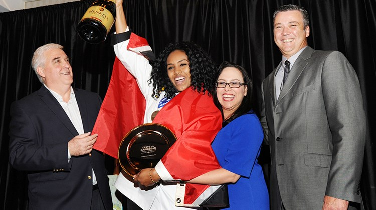 Caribbean Junior Chef of the Year Naomi Lovell, Trinidad and Tobago team, celebrated her award with, from left, Richard Doumeng, president, CHTA; Vanessa Ledesma, director of operations and events, CHTA; and head judge Peter Olsacher, director of research and development for Bahama Breeze Island Grill restaurant chain in the U.S.