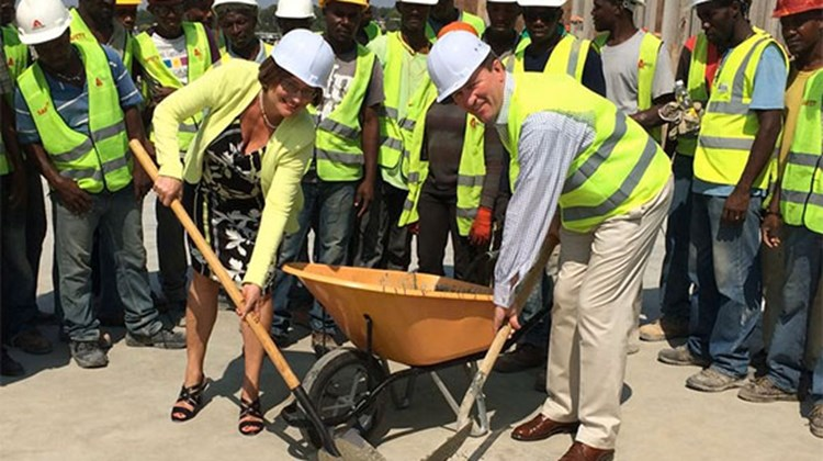 At the topping-off ceremony at the new Marriott Hotel Port-au-Prince in Haiti, scheduled to open in early 2015, are, from left: Ineke Botter, CEO of Digicel Haiti (with shovel) and Andrew Houghton, Marriott International's area vice president, Caribbean and Latin America, surrounded by the Marriott Port-au-Prince construction crew. Digicel Group is designing and building the hotel; Marriott International's Marriott Hotels & Resorts brand is the operating partner under a long-term management contract.