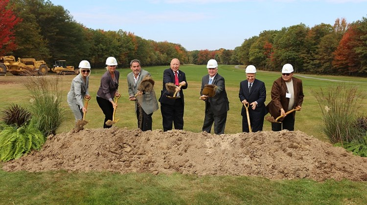 Officials from Kalahari Resorts and Conventions, along with Pennsylvania Gov. Tom Corbett, fifth from left, break ground on the company's newest property site in northeast Pennsylvania's Pocono Mountains, scheduled to open in 2015. From left, Mary Bonte-Spath, Shari Nelson, Todd Nelson, State Rep. Mario Scavello, Corbett, Morris Baily and Steve Pine.