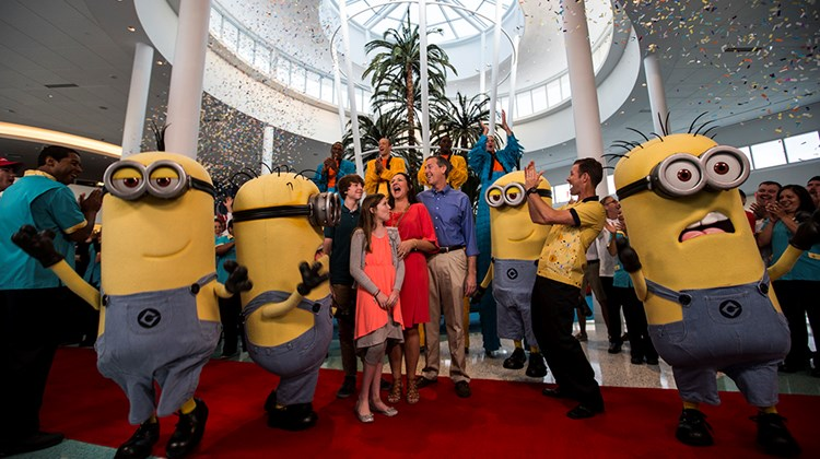 "The Hicks family of St. Petersburg is greeted by Russ Dagon (in yellow shirt), vice president and executive project director at Universal Creative, and the ""Despicable Me"" Minions at the opening of Universal's Cabana Bay Beach Resort in Orlando on March 31. They were the first guests to check in at the retro-inspired hotel, whose amenities include a 10,000-square-foot pool with tower waterslide and a 10-lane bowling alley."