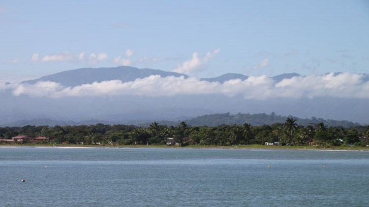 Mountain scenery visible from the port at Limon.