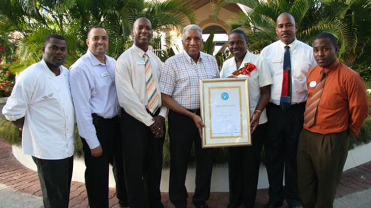 Jesson Church, Ryan Hopkin, Fabian Mitchell, Royston Hopkin, Wendy Charles, Brian Hardy and Seymour Thompson celebrate Spice Island Beach Resort receiving its Green Globe Certification Award.