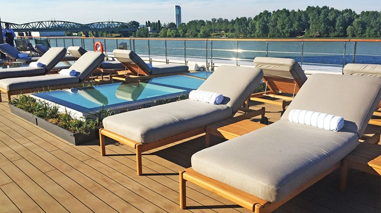 The Vista Deck boasts lounge chairs, a fitness area and a retractable bar.